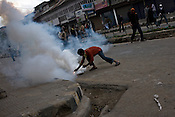 A teenage boy diffuses the tear gas during a protest where protesters raised anti-India and anti-election slogans and clashed with Central Reserve Police Force (CRPF) and J&K Police during a protest in downtown Srinagar on May 8, 2009. Separatists oppose the holding of elections in Kashmir, arguing that they will not resolve the future of the disputed territory, held in part by India and Pakistan but claimed in full by both...Kashmir went into polls on the 4th round of Indian general elections. About 26 percent polling was recorded in the Indian parliamentary elections held in Kashmir on Thursday, May 7th 2009. The poll percentage was on the higher side this year as compared to 2004 polls when 15.04 percent polling was recorded.