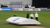 The umpires walk towards the pavilion as the covers are moved into position as rain and bad light stops play during Sussex CCC vs Glamorgan CCC, LV Insurance County Championship Group 3 Cricket at The 1st Central County Ground on 5th July 2021
