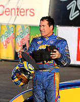 Feb 8, 2015; Pomona, CA, USA; NHRA funny car driver Ron Capps reacts after losing in the final round of the Winternationals at Auto Club Raceway at Pomona. Mandatory Credit: Mark J. Rebilas-