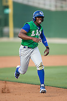Elier Hernandez (12) of the Lexington Legends hustles towards third base against the Kannapolis Intimidators at CMC-Northeast Stadium on May 25, 2015 in Kannapolis, North Carolina.  The Intimidators defeated the Legends 6-5.  (Brian Westerholt/Four Seam Images)