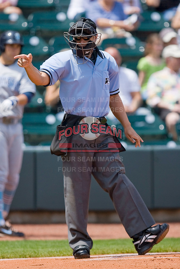 Home plate umpire Joey Amaral signals a strike during a Carolina League game between the Wilmington Blue Rocks and the Winston-Salem Dash at the BB&T Park April25, 2010, in Winston-Salem, North Carolina.  Photo by Brian Westerholt / Four Seam Images