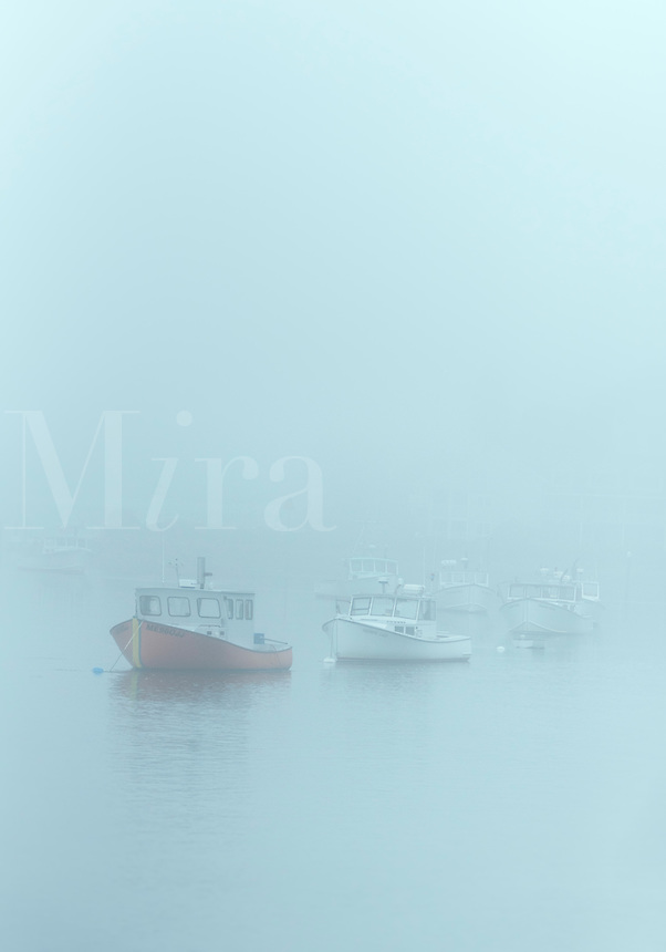 Harbor fishing boats shrouded in heavy fog, Kennebunk, Maine, USA.
