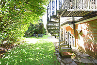 BNPS.co.uk (01202 558833)<br /> Pic:  Riverhomes/BNPS<br /> <br /> Pictured: The garden with a spiral staircase.<br /> <br /> A striking Victorian boathouse that has been used as a film set is on the market for £2m.<br /> <br /> The time capsule building by the River Thames was used in a film version of The Wind in the Willows and the 1996 film True Blue, about the Oxford Cambridge boat race.<br /> <br /> It has an enclosed mooring as well as two moorings on the bank, perfect for those who want to spend their days messing about in boats like Ratty and Mole.