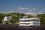 Riverboat Becky Thatcher approaches the Goodspeed Opera House on the Connecticut River in East Haddam, CT, USA