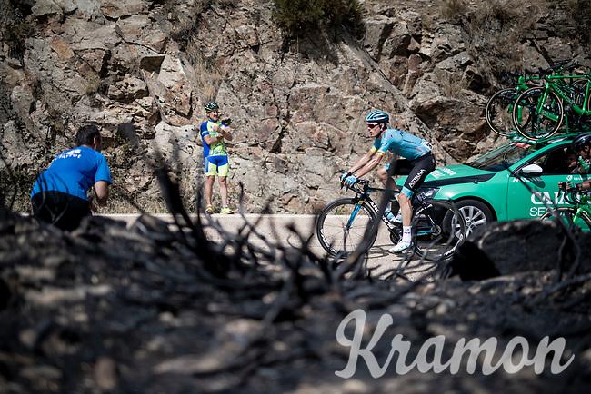 Luis Leon Sanchez (ESP/Astana) up the Puerto de la Morcuera, riding through a stretch that was hit by some wildfire not too long before<br /> <br /> Stage 18: Colmenar Viejo to Becerril de la Sierra (178km)<br /> La Vuelta 2019<br /> <br /> ©kramon