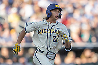 Michigan Wolverines outfielder Jordan Brewer (22) runs to first base against the Vanderbilt Commodores during Game 1 of the NCAA College World Series Finals on June 24, 2019 at TD Ameritrade Park in Omaha, Nebraska. Michigan defeated Vanderbilt 7-4. (Andrew Woolley/Four Seam Images)
