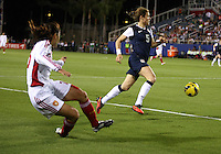 BOCA RATON, FL - DECEMBER 15, 2012: Kelley O'Hara (5) of the USA WNT of misses a cross from Huang Yini (20)  China WNT during an international friendly match at FAU Stadium, in Boca Raton, Florida, on Saturday, December 15, 2012. USA won 4-1.