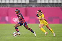 KASHIMA, JAPAN - AUGUST 5: Crystal Dunn #2 of the United States is chased by Hayley Raso #16 of Australia during a game between Australia and USWNT at Kashima Soccer Stadium on August 5, 2021 in Kashima, Japan.