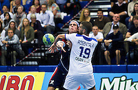 02 NOV 2011 - LONDON, GBR - Britain's Martin Hare (left - blue and red) is challenged by Israel's Ariel Rosental (#19 - white) during the Men's 2013 World Handball Championship qualification match at the National Sports Centre at Crystal Palace .(PHOTO (C) NIGEL FARROW)