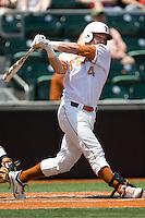 Catcher Kevin Lusson #14 of the Texas Longhorns swings against Texas Tech on April 17, 2011 at UFCU Disch-Falk Field in Austin, Texas. (Photo by Andrew Woolley / Four Seam Images)