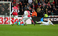 Pictured: Gervinho of Arsenal (27) scoring his goal, Angel Rangel (22), Garry Monk (16) and goalkeeper Michel Vorm (in blue) all of Swansea fail to stop him . Saturday 16 March 2013<br /> Re: Barclay's Premier League, Swansea City FC v Arsenal at the Liberty Stadium, south Wales.