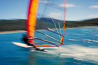 red & orange windsurfer speeding by. Saint Thomas Virgin Islands United States caribbean.