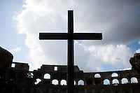 A crucifix is seen at the Colosseum on Wednesday, Sept. 23, 2015, in Rome, Italy. (Photo by James Brosher)