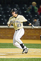 Jimmy Redovian (23) of the Wake Forest Demon Deacons follows through on his swing against the North Carolina State Wolfpack at Wake Forest Baseball Park on March 15, 2013 in Winston-Salem, North Carolina.  The Wolfpack defeated the Demon Deacons 12-6.  (Brian Westerholt/Four Seam Images)