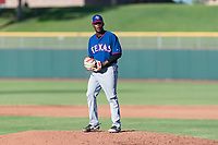AZL Rangers relief pitcher Ediberto Encarnacion (31) gets ready to deliver a pitch during an Arizona League game against the AZL Giants Black at Scottsdale Stadium on August 4, 2018 in Scottsdale, Arizona. The AZL Giants Black defeated the AZL Rangers by a score of 3-2 in the first game of a doubleheader. (Zachary Lucy/Four Seam Images)