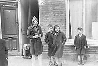 Photo from the NIOD's Huizinga collection. Children on the street during the Hunger Winter. Menno Huizinga was part of the Hidden Camera and took pictures illegally during the occupation.<br /> <br /> The Dutch famine of 1944–45, known in the Netherlands as the Hongerwinter (literal translation: hunger winter), was a famine that took place in the German-occupied Netherlands, especially in the densely populated western provinces north of the great rivers, during the winter of 1944–45, near the end of World War II.