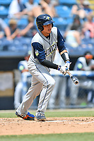 Columbia Fireflies Juan Uriarte (17) swings at a pitch during a game against the Asheville Tourists at McCormick Field on June 23, 2019 in Asheville, North Carolina. The Fireflies defeated the Tourists 11-9. (Tony Farlow/Four Seam Images)