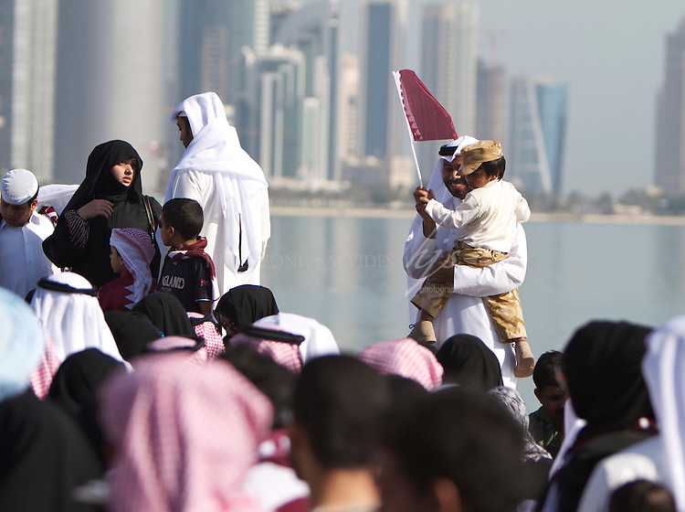 Father and the son with the national flag, Doha, Qatar | Dec 10