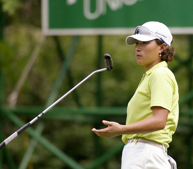 Se Ri Pak of Korea flips her club after missng a putt on the 16th green during the third round of the LPGA Betsy King Classic tournament Saturday, Aug. 24, 2002 in Kutztown, PA. (AP Photo/Brad C Bower)