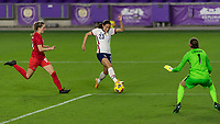 ORLANDO CITY, FL - FEBRUARY 18: Christen Press #23 takes a shot during a game between Canada and USWNT at Exploria stadium on February 18, 2021 in Orlando City, Florida.
