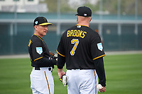 Pittsburgh Pirates coach Rick Eckstein (41) talks with Garth Brooks (7) during the teams first Spring Training practice on February 18, 2019 at Pirate City in Bradenton, Florida.  (Mike Janes/Four Seam Images)