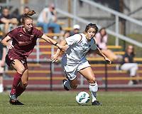 Boston College forward Stephanie McCaffrey (9) dribbles as Virginia Tech defender Jodie Zelenky (6) defends.Virginia Tech (maroon) defeated Boston College (white), 1-0, at Newton Soccer Field, on September 22, 2013.