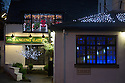 """30/11/15<br /> <br /> It has taken a team of five, two weeks to put up this stunning display of Christmas decorations in what is believed to be one of Britain's most festive pubs. The race was on to put up the 7,500 baubles and 27,000 fairy lights, before guests arrived for the pub's first Christmas parties held last night. <br /> <br /> Each of the five rooms at the Hanging Gate at Chapel-en-le-Frith in the Derbyshire Peak District has a different theme or colour. This year the main restaurant is the Indoor Igloo, the bar area is purple and gold and there's the Candy Cain room upstairs in the pub near Buxton. There's also has another 10,000 lights on the outside of the building. <br /> <br /> """"We've had to replace a few thousand of the LED lights this year, I buy them in huge lengths so it's cost lots  to get everything ready"""" said landlord Mark Thomas.<br /> <br /> <br /> All Rights Reserved: F Stop Press Ltd. +44(0)1335 418365   www.fstoppress.com."""