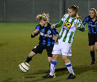20131213 - VARSENARE , BELGIUM : Brugge's Yana Haesebroek (left) pictured with Zwolle's Jennieke Van Der Pol during the female soccer match between Club Brugge Vrouwen and PEC Zwolle Ladies , of  matchday 14  in the BENELEAGUE competition. Friday 13th December 2013. PHOTO DAVID CATRY