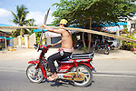 Man On Motorbike With Constuction Material