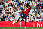 Lucas Vazquez of Real Madrid competes for the ball with Juan Fuentes of Osasuna during the La Liga match between Real Madrid and Osasuna at the Santiago Bernabeu Stadium on 10 September 2016 in Madrid, Spain. Photo by Diego Gonzalez Souto / Power Sport Images