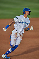 Josh Broughton (14) of the Ogden Raptors hustles to third base during the game against the Grand Junction Rockies at Lindquist Field on June 5, 2021 in Ogden, Utah. The Raptors defeated the Rockies 18-1. (Stephen Smith/Four Seam Images)