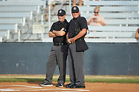 Umpires Gary Keller (left) and Britt Kennerly (right) prior to the Southern Collegiate Baseball League game between the Lake Norman Copperheads and the Mooresville Spinners at Moor Park on July 6, 2020 in Mooresville, NC.  The Spinners defeated the Copperheads 3-2. (Brian Westerholt/Four Seam Images)
