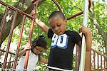 Education Preschool 3-4 year olds outside playground boy preparing to slide down pole