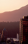 Vancouver, West End neigborhood, condominium towers border Stanley Park at Sunset, Coast Mountains, British Columbia, Canada,.