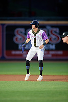 """Akron RubberDucks Nolan Jones (17) leads off second base during an Eastern League game against the Erie SeaWolves on August 30, 2019 at Canal Park in Akron, Ohio.  Akron wore special jerseys with the slogan """"Fight Like a Kid"""" during the game for Akron Children's Hospital Home Run for Life event, the design was created by 11 year old Macy Carmichael.  Erie defeated Akron 3-2.  (Mike Janes/Four Seam Images)"""