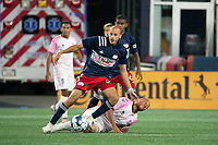 FOXBOROUGH, MA - SEPTEMBER 04: Tiago Mendonca #33 of New England Revolution II passes the ball after tackling J.C. Banks #10 Forward Madison FC during a game between Forward Madison FC and New England Revolution II at Gillette Stadium on September 04, 2020 in Foxborough, Massachusetts.