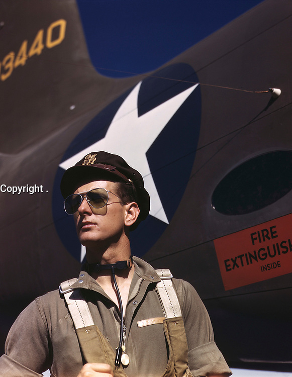 """Lieutenant F.W. """"Mike"""" Hunter, Army pilot assigned to Douglas Aircraft Company, Long Beach, Calif. Photo by Alfred T. Palmer for the Office of War Information, October 1942."""