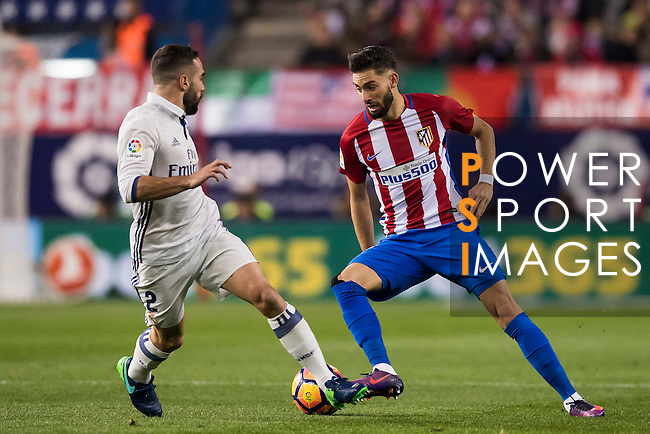 Daniel Carvajal Ramos of Real Madrid fights for the ball with Yannick Ferreira Carrasco of Atletico de Madrid during their La Liga match between Atletico de Madrid and Real Madrid at the Vicente Calderón Stadium on 19 November 2016 in Madrid, Spain. Photo by Diego Gonzalez Souto / Power Sport Images