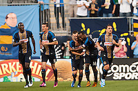 Amobi Okugo (14) of the Philadelphia Union celebrates scoring with Jack McInerney (9) during the first half against the Los Angeles Galaxy during a Major League Soccer (MLS) match at PPL Park in Chester, PA, on May 15, 2013.