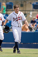 Phil Gosselin #30 of the Rome Braves is congratulated by a teammate after hitting his first professional home run against the Greenville Drive at State Mutual Stadium July 25, 2010, in Rome, Georgia.  Photo by Brian Westerholt / Four Seam Images