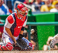 25 July 2013: Washington Nationals catcher Kurt Suzuki blocks a low pitch during a game against the Pittsburgh Pirates at Nationals Park in Washington, DC. The Nationals salvaged the last game of their series, winning 9-7 ending their 6-game losing streak. Mandatory Credit: Ed Wolfstein Photo *** RAW (NEF) Image File Available ***