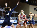 SIOUX FALLS, SD - MARCH 6: Hannah Sjerven #34 of the South Dakota Coyotes shoots past Regan Schumacher #20 of the Oral Roberts Golden Eagles during the Summit League Basketball Tournament at the Sanford Pentagon in Sioux Falls, SD. (Photo by Richard Carlson/Inertia)