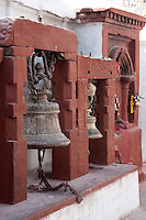 Bodhnath, Nepal.  Bells near the Entrance to a Shrine  adjacent to the Stupa of Bodhnath.