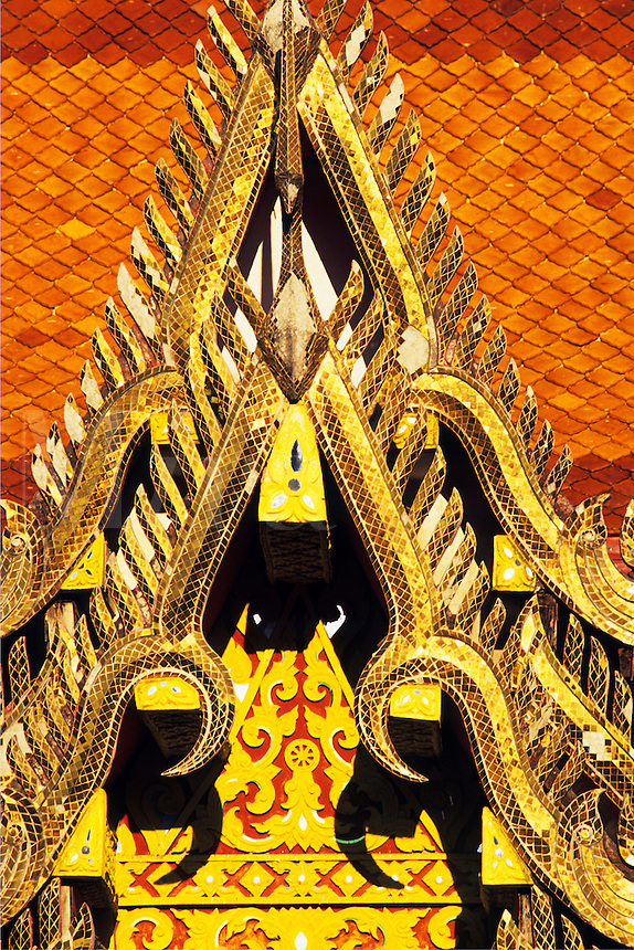 Thailand. Ornate decorated gable end of Thai Buddhist temple.