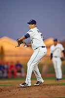 Tri-City Dust Devils starting pitcher Gabriel Morales (13) attempts to pick off a runner at first base during a Northwest League game against the Vancouver Canadians at Gesa Stadium on August 21, 2019 in Pasco, Washington. Vancouver defeated Tri-City 1-0. (Zachary Lucy/Four Seam Images)