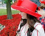 ARLINGTON HEIGHTS, IL - AUGUST 12: A woman wait in line for the Best Dressed Competition on Arlington Million Day at Arlington Park on August 12, 2017 in Arlington Heights, Illinois. (Photo by Jon Durr/Eclipse Sportswire/Getty Images)