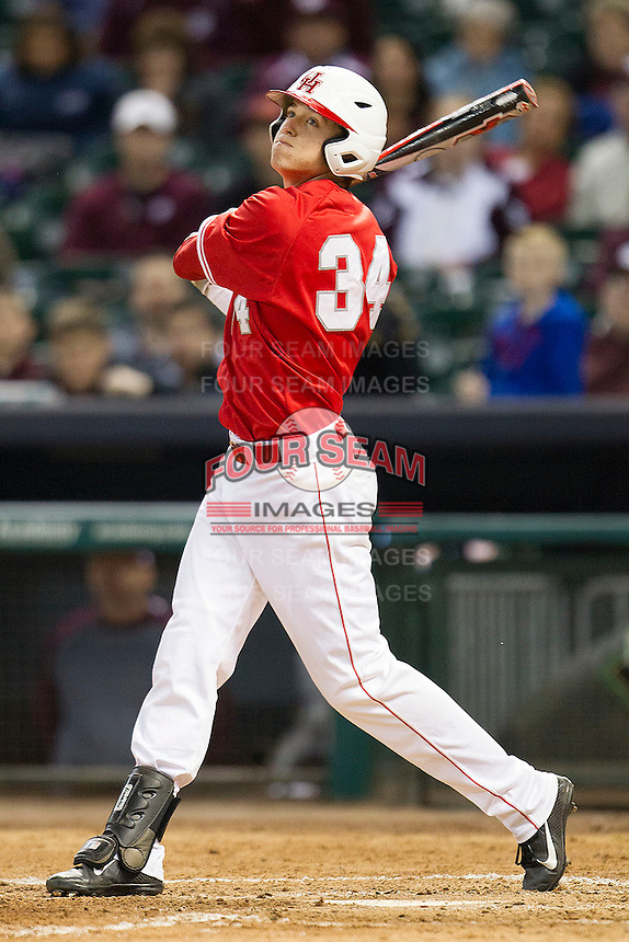 Houston Cougar outfielder Kyle Survance #34 follows through on his swing against the Texas A&M Aggies in the NCAA baseball game on March 1st, 2013 at Minute Maid Park in Houston, Texas. Houston defeated Texas A&M 7-6. (Andrew Woolley/Four Seam Images).