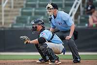 Hickory Crawdads catcher Alex Kowalczyk (22) sets a target as home plate umpire Mike Snover looks on during the game against the Kannapolis Intimidators  in game one of a double-header at Kannapolis Intimidators Stadium on May 19, 2017 in Kannapolis, North Carolina.  The Crawdads defeated the Intimidators 5-4.  (Brian Westerholt/Four Seam Images)
