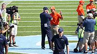 CHAPEL HILL, NC - SEPTEMBER 28: Dabo Swinney of Clemson University talks with head coach Mack Brown of the University of North Carolina during a game between Clemson University and University of North Carolina at Kenan Memorial Stadium on September 28, 2019 in Chapel Hill, North Carolina.