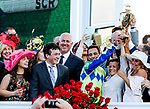 LOUISVILLE, KY - MAY 06: Connections hold up the winner's trophy after  Always Dreaming #5 won the Kentucky Derby on Kentucky Derby Day at Churchill Downs on May 6, 2017 in Louisville, Kentucky. (Photo by Candice Chavez/Eclipse Sportswire/Getty Images)